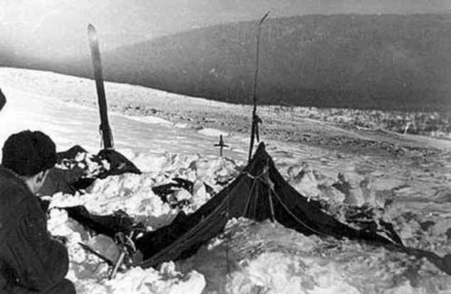 A view of the tent as the rescuers found it on Feb. 26, 1959. The tent had been cut open from inside, and most of the skiers had fled in socks or barefoot. Photo taken by soviet authorities at the camp of the Dyatlov Pass incident and anexed to the legal inquest that investigated the deaths.